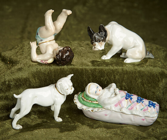 "4 1/2""  Four German porcelain figurines, taufling baby trinket box, cherub and two dogs. $500/700"