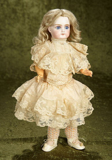 "15"" Sonneberg bisque closed mouth child doll, lovely lace dress by Gebruder Kuhnlenz. $800/1000"