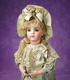 French Bisque Bebe by Leon Casimir Bru, Teal Silk Costume, Signed Shoes 11,000/15,000
