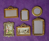Six Dollhouse Mirrors and Prints in Gilt and Ormolu Frames 300/400