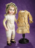 Bisque Bebe by Leon Casimir Bru, Signed Shoes and Au Nain Bleu Dress 11,000/16,000