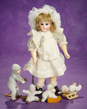 Petite Sonneberg Closed Bisque Doll in the French Manner 600/900