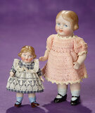 Two German All-Bisque Googly Dolls with Sculpted Hair in Side Coils 400/500