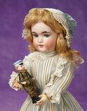 German Bisque Child, 1250, by Franz Schmidt with Little Bisque Doll 400/500