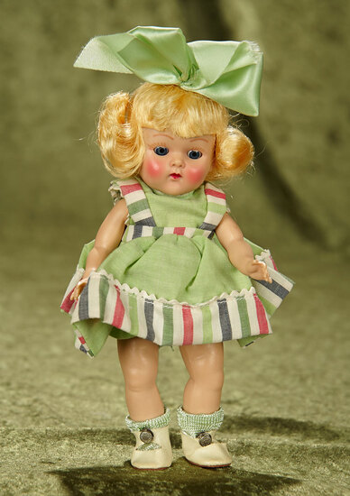 "8"" Blonde Haired Painted Lash Ginny in Green Sundress, Hair Bow by Vogue,1952/53. $400/500"