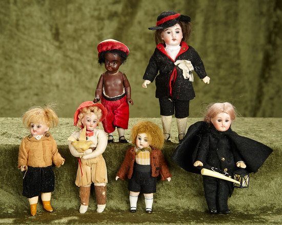 "4.5""-6.5"" Small German bisque dolls with wonderful costumes."