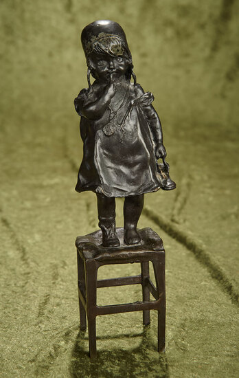 "12"" Cast bronze statue of ""Young Girl On Stool With Shoe"" signed by Juan Clara."