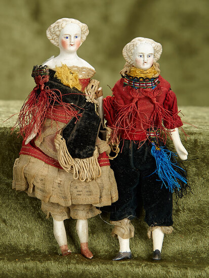 "5.5""- 6""  Pair of dollhouse size German bisque dolls, frail original folklore costumes."