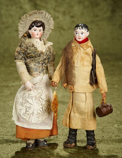 """Pair, 10"""" French bisque shoulderhead dolls in original Pas de Calais folklore costumes. $1100/1300"""
