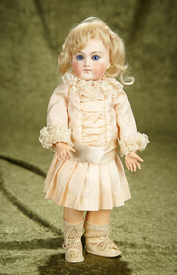 """11"""" Sonneberg bisque closed mouth doll in petite size. $800/900"""