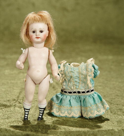 """6 1/2"""" German all-bisque miniature doll with swivel head by Kestner, fancy boots. $600/800"""