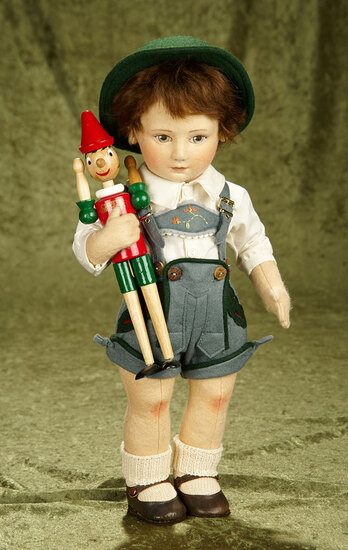 """17"""" American felt """"Max and His Pinocchio"""" by R. John Wright  $800/1100"""