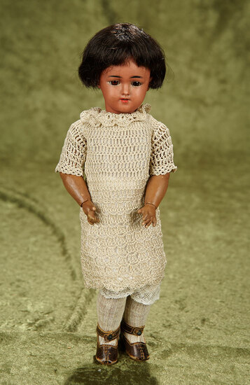 """12"""" Petite German brown-complexioned bisque doll, model 1249, by Simon and Halbig. $500/700"""