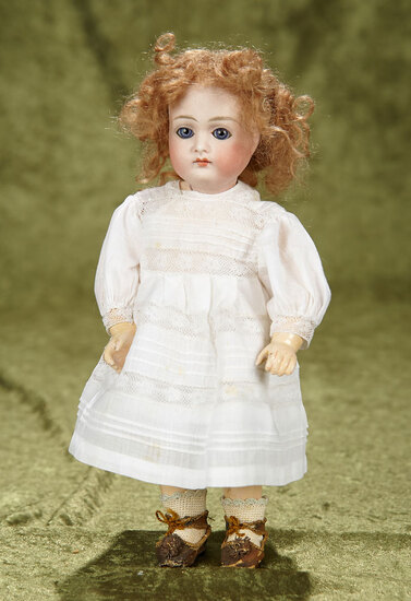 """10"""" Petite German bisque closed mouth doll with original early body. $800/1000"""