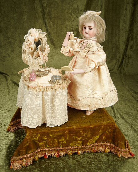 """20"""" French Bisque Musical Automaton """"Little Girl at the Toilette Table"""" by Lambert. $5000/7500"""