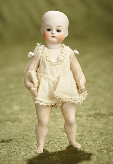 """5"""" German all-bisque miniature doll with muscular legs, bare feet, closed mouth. $400/500"""