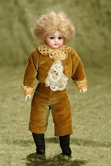 """8"""" German bisque closed mouth doll, 950, by Simon and Halbig in rare tiny size. $400/500"""