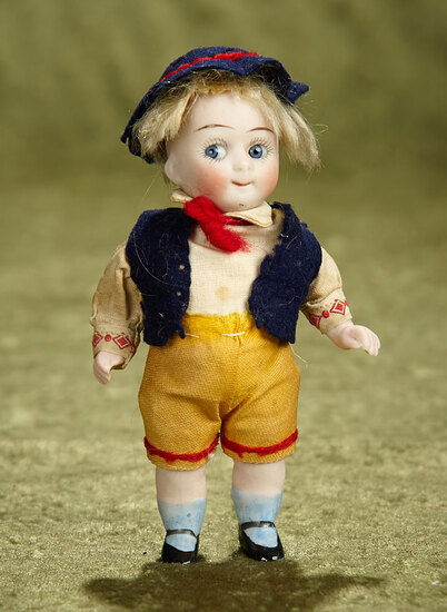 """5"""" German all-bisque googly with factory-original costume. $500/700"""