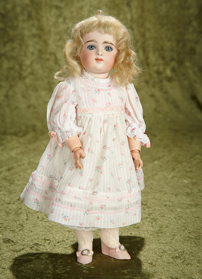 """13"""" German bisque closed mouth child with original wig and body by Kestner. $1100/1300"""