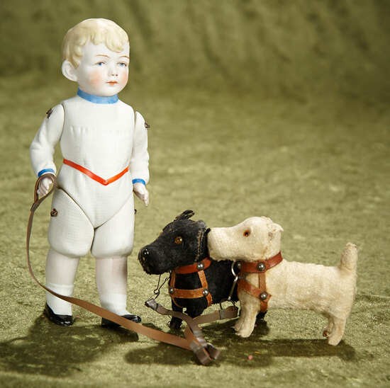 """8"""" German all-bisque boy with blonde sculpted hair and costume, with two pet pups. $400/500"""