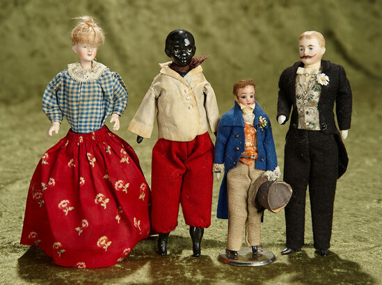 "Four 6""-7"" German bisque dollhouse dolls, fancily dressed men, wigged woman. $700/900"