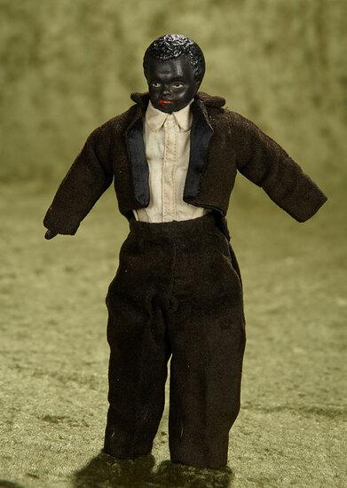 "9"" German bisque dollhouse man with black complexion, antique costume. $200/300"