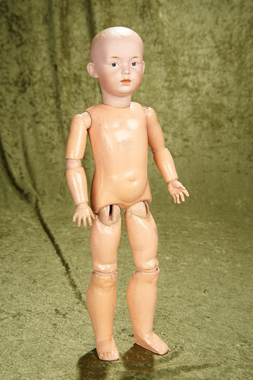 """19"""" German bisque character boy with somber expression by Gebruder Heubach."""