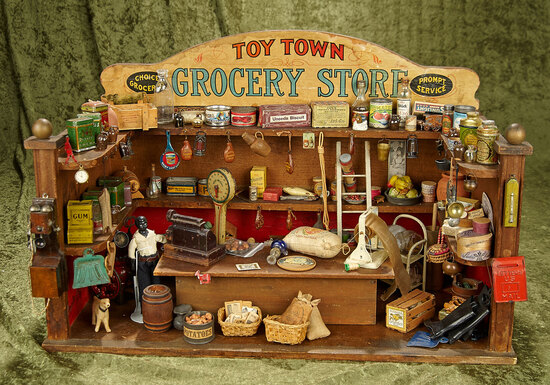 "23"" Parker Brothers paper lithograph-over-wood  ""Toy Town Grocery Store"" filled with contents."