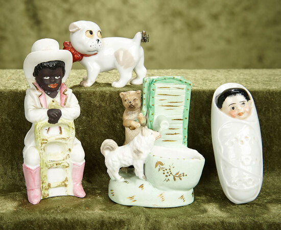 Lot of German bisque and porcelain figurines, bank and match holder vase.