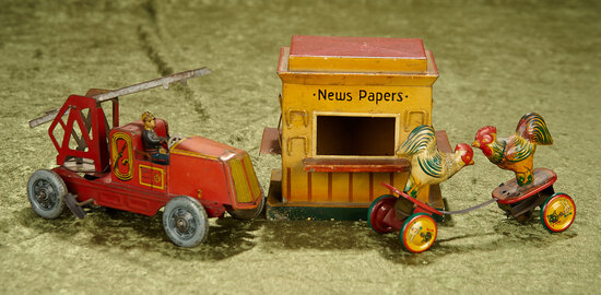 "5-7"" Three Vintage tin toys in good working condition, Fire Truck, Chickens and News Paper Kiosk."