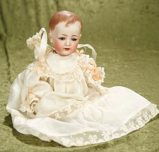 "11"" German bisque K*R 125 character baby with excellent bisque and sleep eyes."