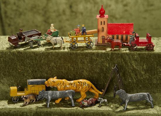 "1/2""-4"" Lot of miniature, German Erzgebirge toy vehicles and cast metal animals."