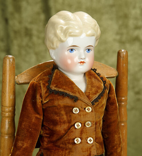 """20"""" German porcelain blonde haired china on original cloth and leather body, in a velvet suit."""
