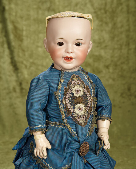 """18"""" French bisque SFBJ 236 smiling character on a clean composition toddler body with sleep eyes."""