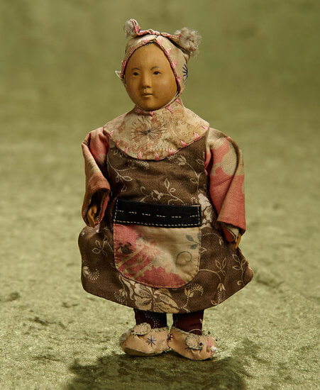 """6 1/2"""" Petite wooden Door Of Hope Mission child in original rabbit style outfit and moccasins."""