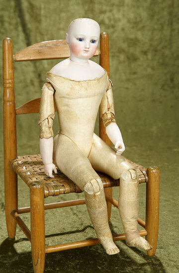 """17 1/2"""" French bisque poupee on a rare, kid-covered-wood fashion body with cobalt eyes."""