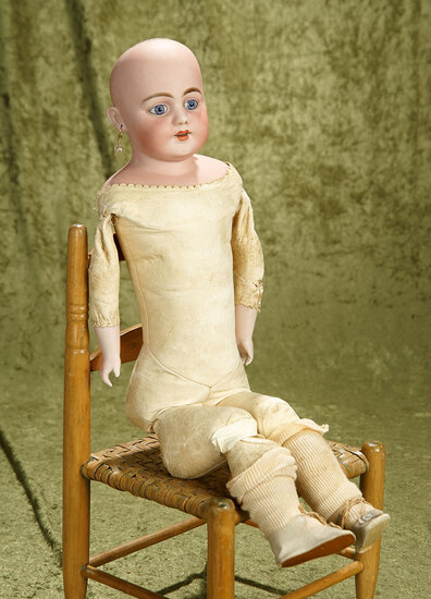 """21"""" German bisque 1010 shoulder head by Simon & Halbig with blue paperweight eyes."""