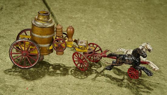 "17"" Antique cast iron horse-drawn pumper fire truck toy."