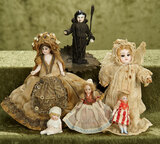 Lot of miniature German and French bisque dolls with original costumes.