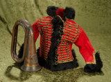 Red wool flannel jacket with fur trim and brass buttons, with brass trumpet.