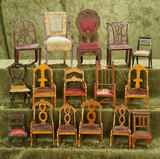 Collection of 15 antique dollhouse chairs in various styles
