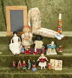 Lot of miniature dolls and toys