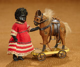 German All-Bisque Miniature Doll with Ebony Complexion, with Toy Horse 400/600