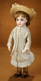 French Bisque Blue-Eyed Bebe by Leon Casimir Bru in Early Dress 3500/4500