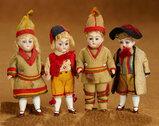 Four German All-Bisque Miniature Dolls in Factory-Original Costumes 300/500