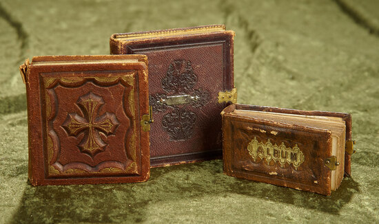 "2-4"" Two antique tintype albums and a daguerreotype in leather souvenir frame."