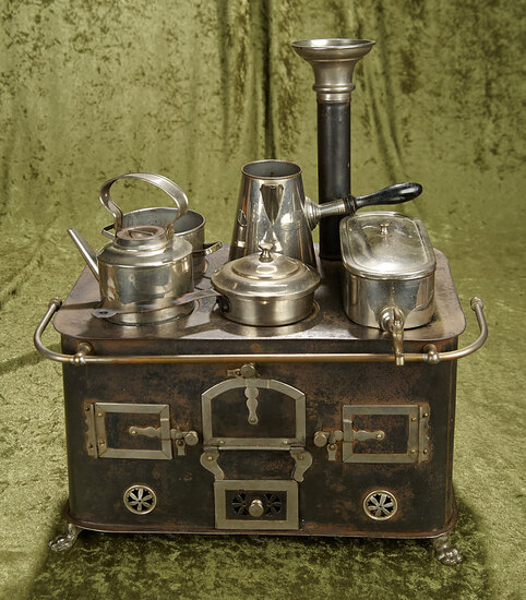 "15"" German tin stove with silver trim, claw feet, pots and pans."