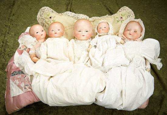 "18"" Group of five small German bisque AM Dreambabies presented in a basket."