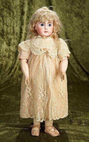 "20"" French bisque bebe by Jules Steiner, signed Steiner body, antique costume. $2800/3200"