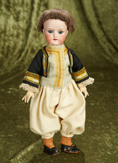 "15"" Bisque doll for the French market, Au Nain Bleu label, original Brittany costume. $400/500"